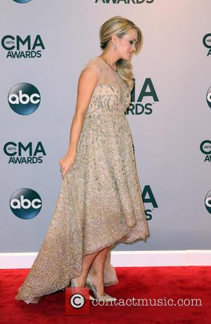 Carrie Underwood - Shots of a variety of stars as they took to the red carpet for the 48th Annual...