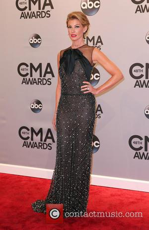 Faith Hill - Shots of a variety of stars as they took to the red carpet for the 48th Annual...