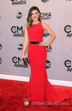 Lucy Hale - Shots of a variety of stars as they took to the red carpet for the 48th Annual...