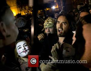 Russell Brand - Thousands of disenfranchised protesters wearing masks including British comedian Russel Brand took to the streets in the...