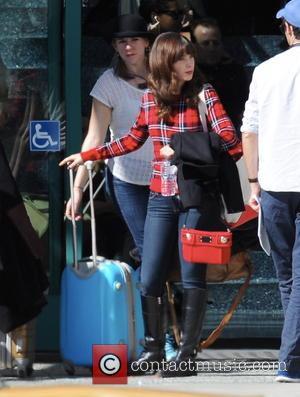 Zooey Deschanel - Actress Zooey Deschanel filming the Christmas episode for FOX's hit show 'New Girl' in downtown Los Angeles...