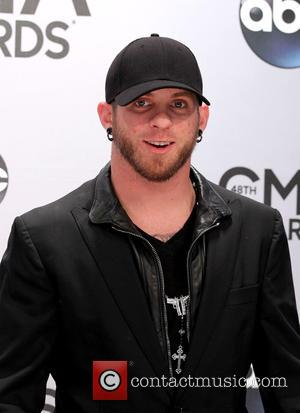 Brantley Gilbert - Shots of a variety of stars as they took to the red carpet for the 48th Annual...