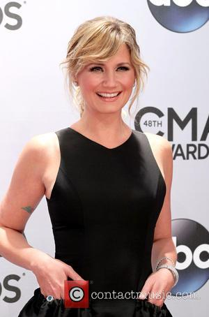 Jennifer Nettles - Shots of a variety of stars as they took to the red carpet for the 48th Annual...