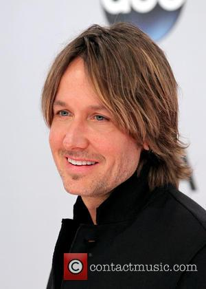 Keith Urban - 48th Annual CMA Awards 2014 Arrivals at...
