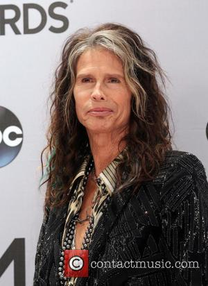 Steven Tyler - Shots of a variety of stars as they took to the red carpet for the 48th Annual...
