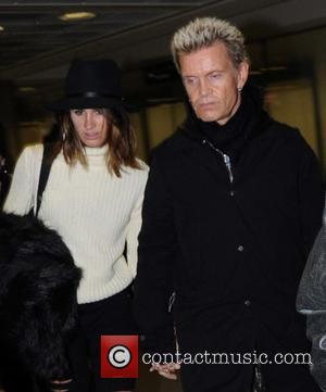 Billy Idol - Rock star Billy Idol arriving at Dublin Airport holding hands with a mystery woman who doesn't appear...