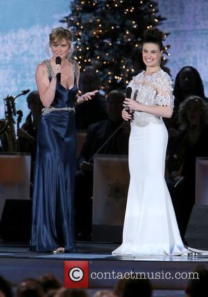 Jennifer Nettles and Idina Menzel - 2014 CMA Country Christmas at Bridgestone Arena - Performances at Bridgestone Arena - Nashville,...