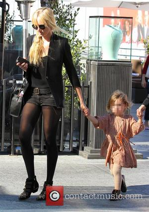 Kimberly Stewart and Delilah del Toro - Kimberly Stewart takes her daughter Delilah to watch 'Big Hero 6' - Los...
