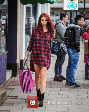 Amy Childs - Amy Childs and Harry Derbidge out and about Brentwood. Amy wears an oversized checked shirt, showing her...