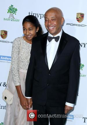 Russell Simmons and Aoki Lee Simmons - A variety of stars were photographed as they arrived at the 2014 Gala...