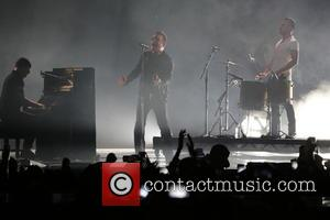 The Edge (l-r), Bono and Larry Mullen Jr. Of U2