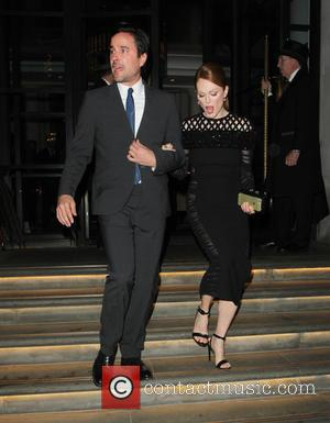 Bart Freundlich and Julianne Moore - Celebrities leaving the Corinthia Hotel London to attend The Hunger Games premiere - London,...