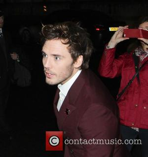 Sam Claflin - Celebrities leaving the Corinthia Hotel London to attend The Hunger Games premiere - London, United Kingdom -...