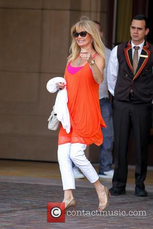Goldie Hawn - Goldie Hawn wearing a bright orange camisole, leaves the Montage Hotel - Los Angeles, California, United States...