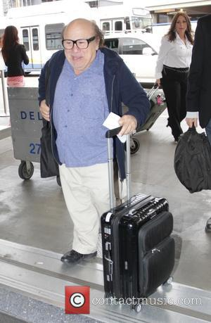 Danny Devito - Danny DeVito is all smiles as he arrives at Los Angeles International Airport (LAX) - Los Angeles,...