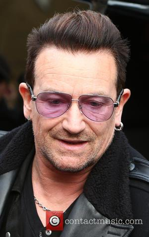 Bono - Photographs of a variety of musical stars as they arrive at SARM Studio to record the 2014 version...