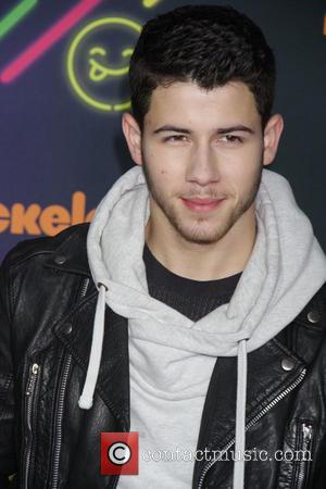 Nick Jonas Busks In Subway Station