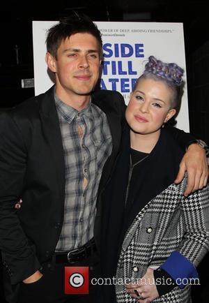 Chris Lowell and Kelly Osbourne