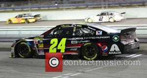 Jeff Gordon and driver of the #24 Drive To End Hunger Chevrolet - NASCAR Sprint Cup Series Ford EcoBoost 400...