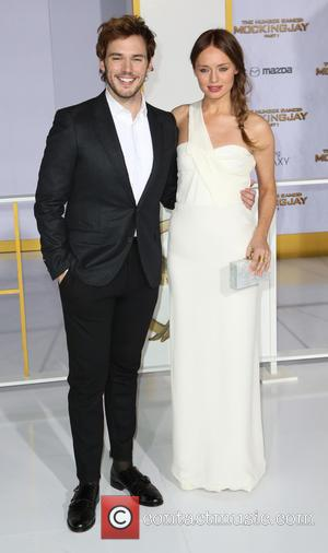 Sam Claflin and Laura Haddock - 'The Hunger Games: Mockingjay - Part 1' Los Angeles premiere at Nokia Theatre -...