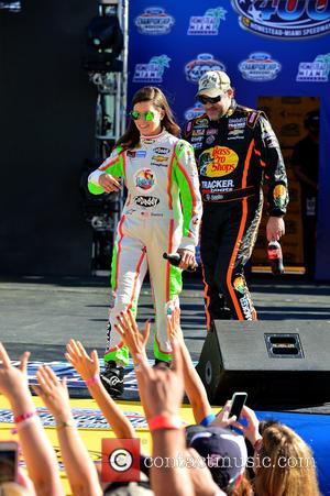 Danica Patrick, driver of the #10 Florida Lottery/GoDaddy Chevrolet, Tony Stewart and driver of the #14 Bass Pro Shops / Mobil 1 Chevrolet