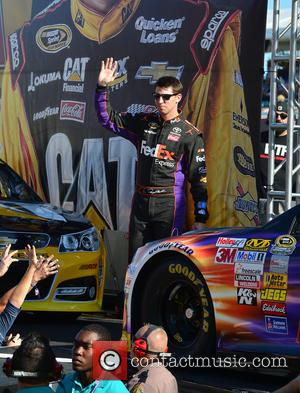 Denny Hamlin and Driver Of The #11 Fedex Express Toyota