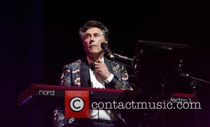 Snaps of English singer songwriter Bryan Ferry as he performs live in concert at the Heineken Music Hall in Amsterdam,...