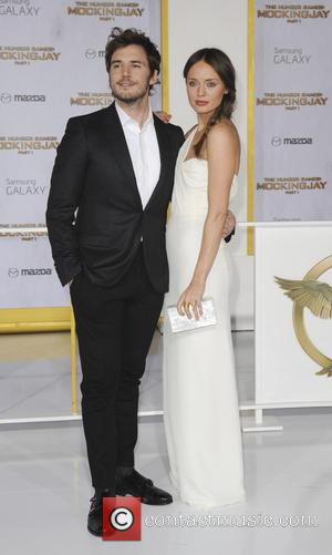 Laura Haddock and Sam Claflin - Premiere of The Hunger Games Mockingjay  Part One - Los Angeles, California, United...