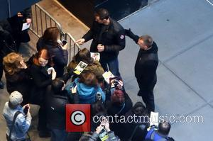 Hugh Jackman, bodyguard and fans - Hugh Jackman departing the theatre after a Broadway matinee of his new show The...