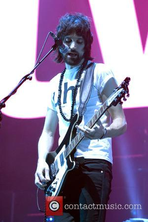 Sergio Pizzorno - Kasabian performing live on stage at the SSE Hydro in the SECC campus in Glasgow at the...