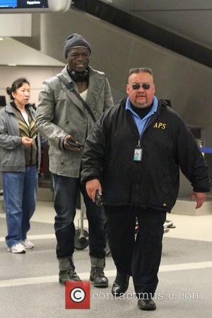 Seal - Singer-songwriter Seal arrives at Los Angeles International Airport (LAX) - Los Angeles, California, United States - Thursday 20th...