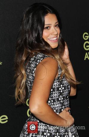 Gina Rodriguez - Photographs of a host of stars as they arrived for the Hollywood Foreign Press Association and InStyle...