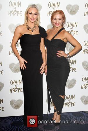 Kristina Rihanoff and Anya Garnis - Chain of Hope's 2014 Gala Ball at the Grosvenor House hotel - Arrivals at...
