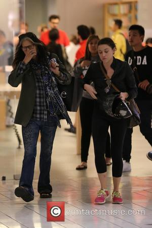 Steven Tyler and Chelsea Tallarico - Steven Tyler and his daughter Chelsea Tallarico shop at the Apple Store in the...
