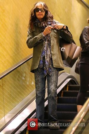 Steven Tyler - Steven Tyler and his daughter Chelsea Tallarico shop at the Apple Store in the Beverly Center at...