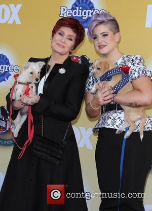 Sharon Osbourne and Kelly Osbourne - Photographs of a host of stars and their dogs as they attended 'Cause For...