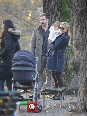 Michelle Hunziker, Tomaso Trussardi and Sole Trussardi - Heavily pregnant Swiss-Italian TV host Michelle Hunziker seen out with her husband...