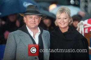 Hugh Bonneville and Lulu Williams - Photographs of a variety of stars as they took to the red carpet for...
