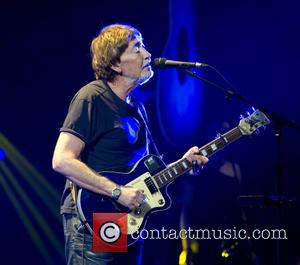 Shots of English singer song writer Chris Rea as he performs live on stage at the Carre Theatre in Amsterdam,...