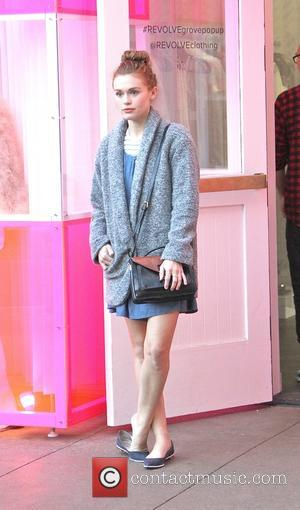 Holland Roden - Teen Wolf actress, Holland Roden waiting outside of Revolve as she goes shopping at The Grove in...