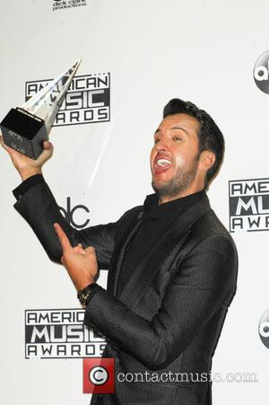 Luke Bryan - Photographs of a wide variety of stars from the music industry as they attended the American Music...