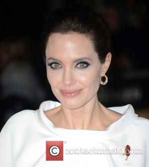 Angelina Jolie - A variety of celebrities were snapped as they took to the red carpet for the U.K. Premiere...
