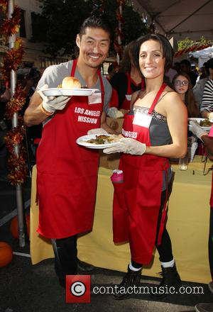 Brian Tee and Mirelly Taylor - Photographs from LA Mission's Annual Thanksgiving for the Homeless which stars attend to help...