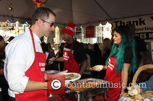 Tyga and Kylie Jenner - Photographs from LA Mission's Annual Thanksgiving for the Homeless which stars attend to help feed...