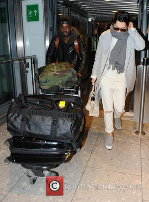 Jessie J and Luke James - Jessie J hides her face with a scarf while her and her boyfriend Luke...