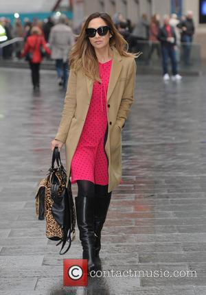 Myleene Klass - Myleene Klass leaves Smooth Radio, wearing a pink spotty dress, tanned coat, black boots and sunglasses. -...