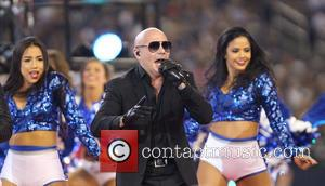 Pitbull performs with Ne-Yo on Thanksgiving during half-time of an NFL football game between the Dallas Cowboys and the Philadelphia...