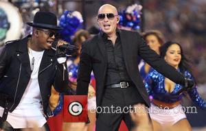 Pitbull - Pitbull performs with Ne-Yo on Thanksgiving during half-time of an NFL football game between the Dallas Cowboys and...