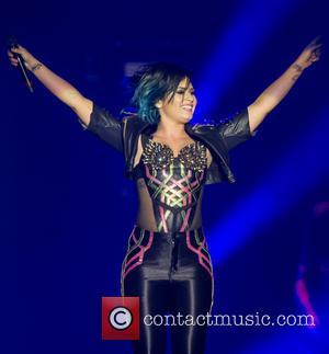 Demi Lovato Fighting Illness On Tour