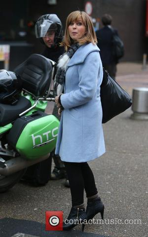 Kate Garraway - Kate Garraway has her hands full when she gets dropped off by a taxi bike in London...